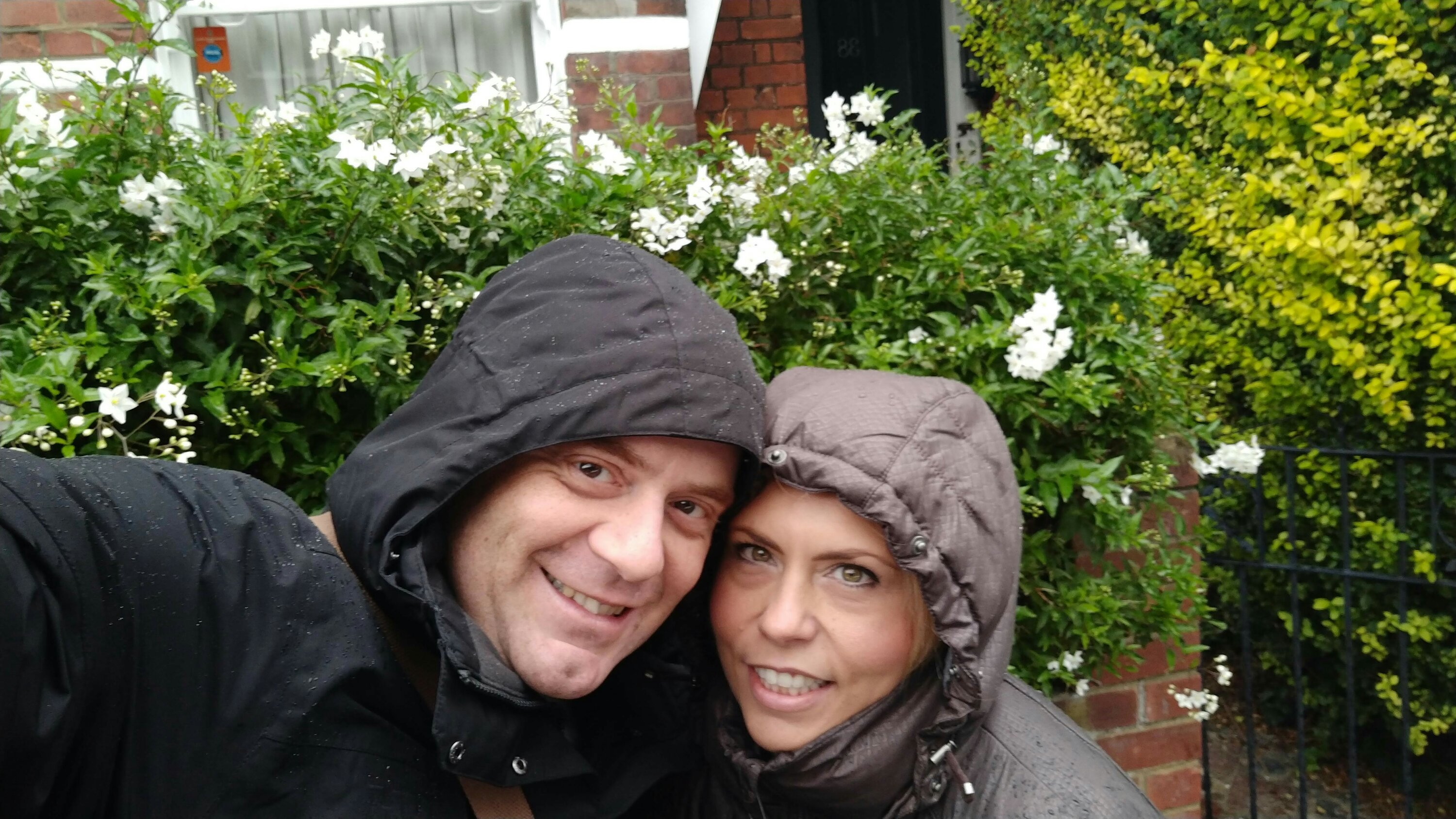 A picture of travel bloggers Crazy Family Travellers wearing hoods in rainy weather