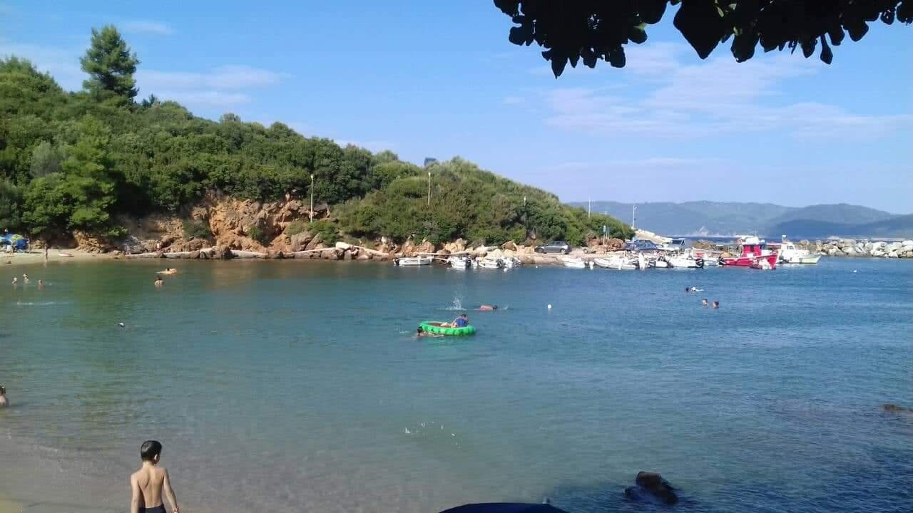 A view of the port of the fishing village of Katigiorgis in Southern Pelion Central Greece showing boats and the Aegean sea.